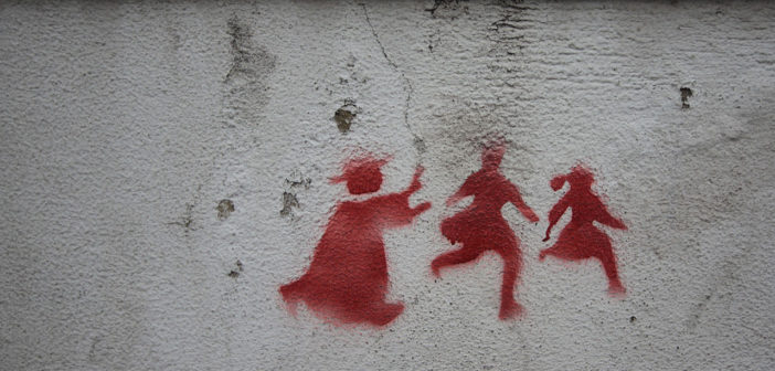 Graffiti on a wall in Lisbon depicting a priest chasing two children, denouncing the child abuse scandal that rocked the catholic churchGraffiti on a wall in Lisbon depicting a priest chasing two children, denouncing the child abuse scandal that rocked the Catholic Church